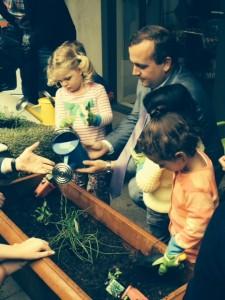 Minister and children gardening