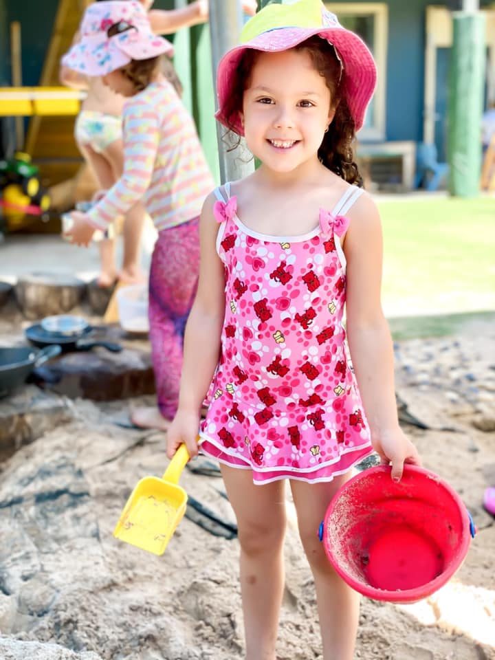 girl with spade and bucket